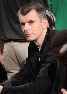 Nets owner Mikhail Prokhorov watches the the 2010 NBA finals in Boston