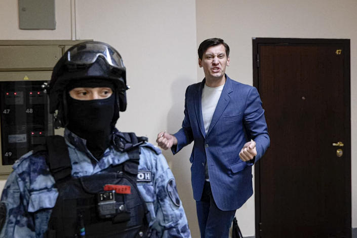 FILE - In this June 1, 2021, frame from video, Russian opposition activist Dmitry Gudkov gestures speaking to the media as police search at his country home outside Moscow, Russia, Tuesday, June 1, 2021. Gudkov, was briefly arrested in June along with his aunt on fraud charges. Gudkov said he had planned to run in a Moscow district against a less-popular United Russia candidate, but authorities pushed him out of the race. (AP Photo/Daniel Kozin, File)
