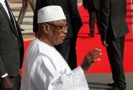 Keita waves as he is seen at the international conference center of Bamako during the France-Africa summit in Bamako