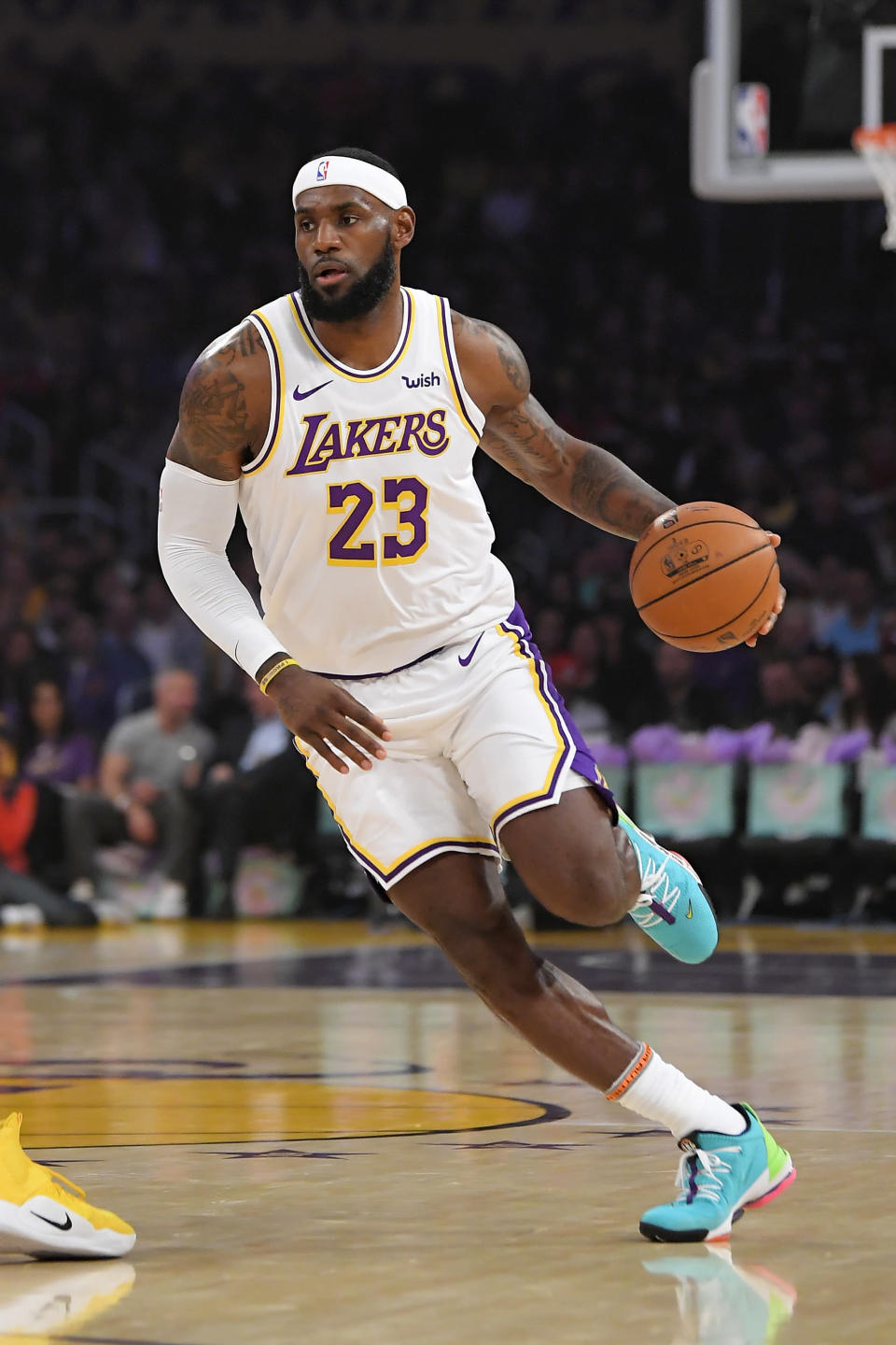 Los Angeles Lakers forward LeBron James dribbles during the first half of the team's preseason NBA basketball game against the Golden State Warriors on Wednesday, Oct. 16, 2019, in Los Angeles. (AP Photo/Mark J. Terrill)