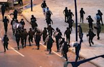 Moroccan riot police retreated as youths threw stones near the border