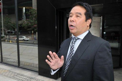 """File photo of Hong Kong tycoon and Birmingham City owner Carson Yeung outside the Wan Chai Law Courts in Hong Kong. He was arrested and charged in June 2011 with five counts of """"dealing with property known or believed to represent proceeds of an indictable offence"""""""