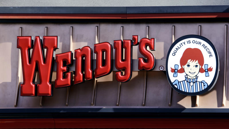 This Jan. 29, 2012 photo, shows a Wendy's sign at a restaurant in Culver City, Calif., Sunday, Jan. 29, 2012.  Fast-food chain Wendy's Co. is changing the way it treats chickens and pigs used in its food in an effort to be more humane.  The company's animal welfare council said Friday, March 23, 2012,  that one of its chicken suppliers, O.K. Foods Inc. of Ft. Smith, Ark., has started using a low-atmospheric pressure system that renders the chickens unconscious before the birds are handled by plant workers. The process, known as LAPS, is criticized by some animal welfare groups but replaces the industry standard practice of stunning chickens with electricity.  (AP Photo/Reed Saxon)