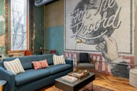 """This industrial loft is among a variety of rentals in one of downtown Nashville's century-old buildings—and is run by local company Anchor Rentals, which also manages <a href=""""https://www.cntraveler.com/hotels/nashville/the-russell?mbid=synd_yahoo_rss"""" rel=""""nofollow noopener"""" target=""""_blank"""" data-ylk=""""slk:The Russell"""" class=""""link rapid-noclick-resp"""">The Russell</a>, a boutique hotel in a renovated East Nashville church. What that means for <a href=""""https://www.cntraveler.com/story/how-to-make-the-most-of-a-solo-business-trip?mbid=synd_yahoo_rss"""" rel=""""nofollow noopener"""" target=""""_blank"""" data-ylk=""""slk:business travelers"""" class=""""link rapid-noclick-resp"""">business travelers</a> is that they won't have to worry about hosts cancelling or needing the space, since it's always open for visitors. This particular apartment, with its ultra-high ceilings, multiple workspaces, and well-equipped kitchen (which includes a microwave, coffee machine, and toaster oven for quick breakfasts), is a great spot for weekday visitors. It's also an Airbnb Plus, so you don't have to pack shampoo, soap, and the like—they'll already be in the bathroom. $171, Airbnb (Starting Price). <a href=""""https://www.airbnb.com/rooms/plus/17140617"""" rel=""""nofollow noopener"""" target=""""_blank"""" data-ylk=""""slk:Get it now!"""" class=""""link rapid-noclick-resp"""">Get it now!</a>"""