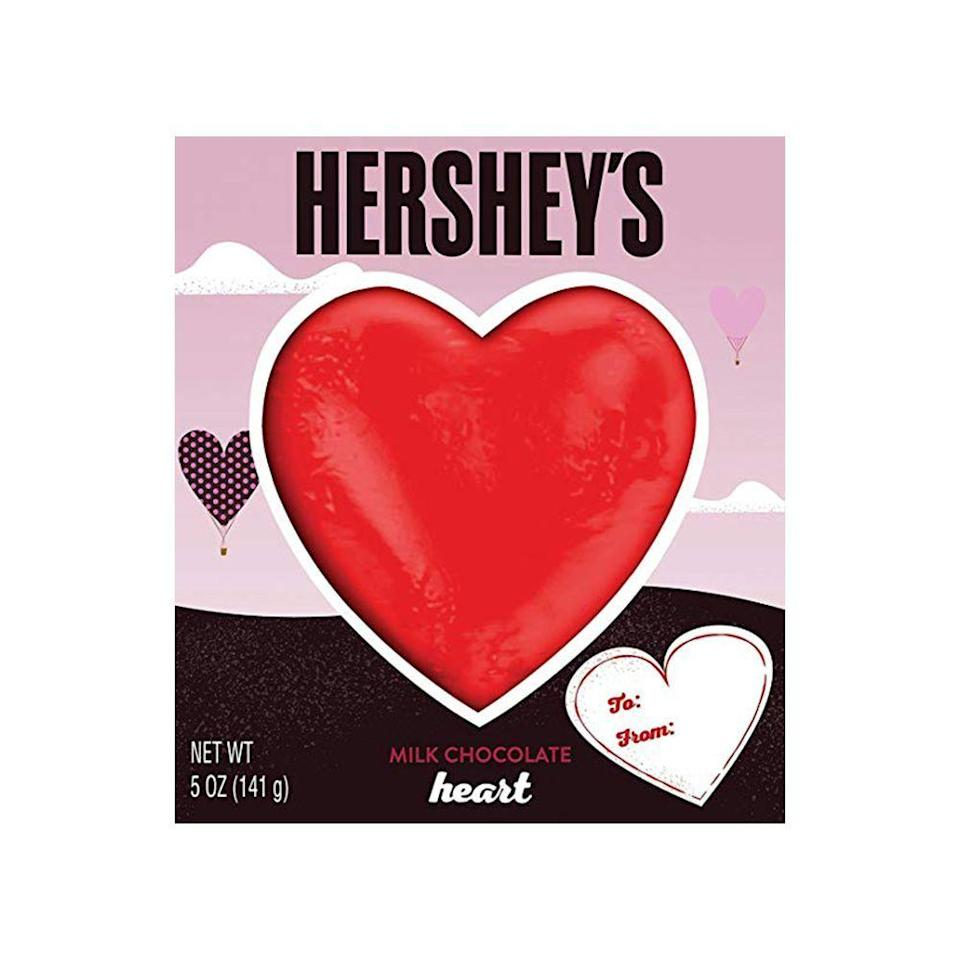 """<p><strong>HERSHEY'S </strong></p><p>walmart.com</p><p><strong>$3.98</strong></p><p><a href=""""https://go.redirectingat.com?id=74968X1596630&url=https%3A%2F%2Fwww.walmart.com%2Fip%2FHERSHEY-S-Solid-Milk-Chocolate-Valentine-s-Day-Heart-Candy-5-ounce-Gift-Box%2F33740334&sref=https%3A%2F%2Fwww.bestproducts.com%2Feats%2Ffood%2Fg904%2Fvalentines-day-candy%2F"""" rel=""""nofollow noopener"""" target=""""_blank"""" data-ylk=""""slk:Shop Now"""" class=""""link rapid-noclick-resp"""">Shop Now</a></p><p>This giant solid milk chocolate heart from Hershey's is <em>technically </em>five servings — but we won't judge you if you eat the whole thing in one sitting. It's that delicious! </p>"""
