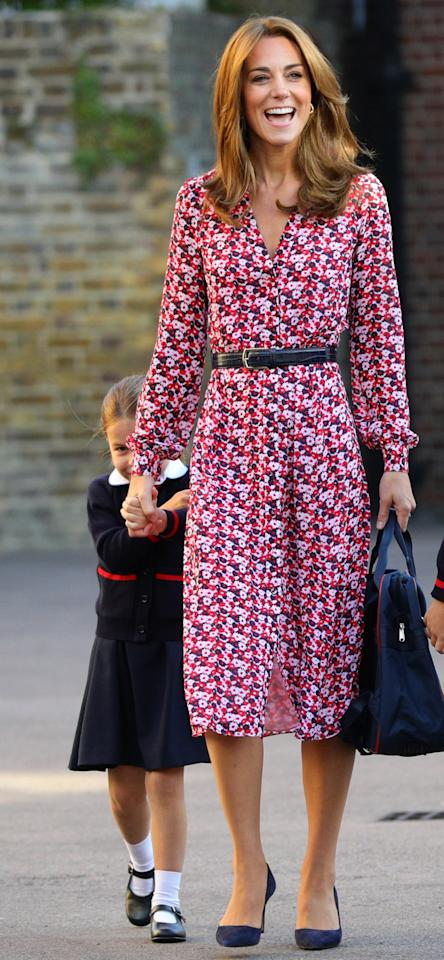 """Princess Charlotte arrived <a href=""""https://people.com/royals/princess-charlotte-starts-school-prince-george-kate-middleton-prince-william-drop-off/"""" target=""""_blank"""">at her first day of school</a> accompanied by her big brother Prince George, Kate Middleton, and Prince William. Kate wore a pink and red floral-print belted midi dress by <a href=""""http://www.anrdoezrs.net/links/8029122/type/dlg/sid/PEO,Shopping:EverythingYouNeedtoCopyKateMiddleton'sSummerStyle,kamiphillips2,Unc,Gal,7115494,201909,I/https://www.michaelkors.com/"""" target=""""_blank"""" rel=""""nofollow"""">Michael Kors</a> (the same dress she wore to Meghan and Harry's wedding rehearsal!), pumps, and her signature bouncy blowout.  <strong>Get the Look!</strong>  Fashion Union Petite Midi Tea Dress in Floral, $56; <a href=""""https://click.linksynergy.com/deeplink?id=93xLBvPhAeE&mid=35719&murl=https%3A%2F%2Fus.asos.com%2Ffashion-union-petite%2Ffashion-union-petite-midi-tea-dress-in-floral%2Fprd%2F12250904&u1=PEO%2CShopping%3AEverythingYouNeedtoCopyKateMiddleton%E2%80%99sSummerStyle%2Ckamiphillips2%2CUnc%2CGal%2C7115494%2C201909%2CI"""" target=""""_blank"""" rel=""""nofollow"""">asos.com</a>  French Connection Cerisier Botanical-Print Midi Dress, $118; <a href=""""https://click.linksynergy.com/deeplink?id=93xLBvPhAeE&mid=13867&murl=https%3A%2F%2Fwww.bloomingdales.com%2Fshop%2Fproduct%2Ffrench-connection-cerisier-botanical-print-midi-dress%3FID%3D3359704&u1=PEO%2CShopping%3AEverythingYouNeedtoCopyKateMiddleton%E2%80%99sSummerStyle%2Ckamiphillips2%2CUnc%2CGal%2C7115494%2C201909%2CI"""" target=""""_blank"""" rel=""""nofollow"""">bloomingdales.com</a>  La Maison Talulah Daiquiri Midi Dress, $96; <a href=""""https://www.amazon.com/Maison-Talulah-Womens-Daiquiri-Strawberry/dp/B07N1Q6VKQ/ref=as_li_ss_tl?keywords=la+maison+talulah+red+floral+dress&qid=1567690794&s=gateway&sr=8-1&linkCode=ll1&tag=poamzfkatemiddletonstylekphillips0919-20&linkId=39ff0a2460f8ba923ab41d0ac45a771e&language=en_US"""" target=""""_blank"""">amazon.com</a>  True Violet Exclusive Long Sleeve Wrap Fron"""