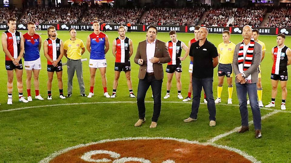 Garry Lyon, Tony Lockett and Stewart Loewe, pictured here addressing players and the crowd.