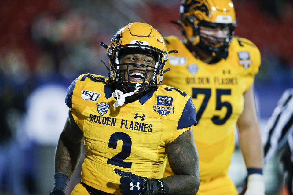Kent State running back Will Matthews (2) celebrates his touchdown during the second half of the Frisco Bowl NCAA college football game against Utah State on Friday, Dec. 20, 2019, in Frisco, Texas. Kent State won 51-41. (AP Photo/Brandon Wade)