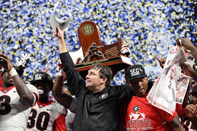 Georgia head coach Kirby Smart celebrates winning the SEC championship with his players. (REUTERS
