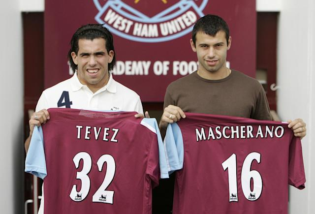 Carlos Tevez and Javier Mascherano look slightly bemused as they are unveiled as West Ham players