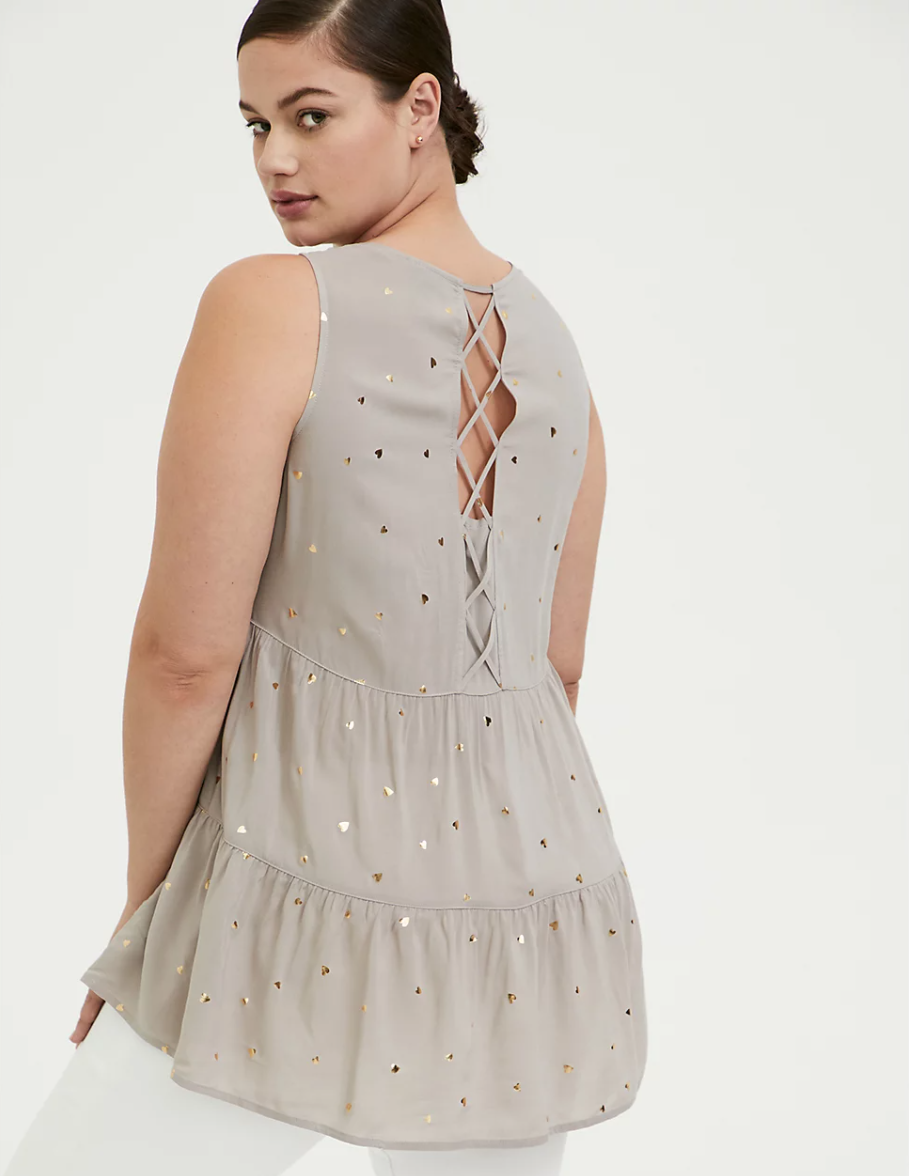 """<h3><a href=""""https://www.torrid.com/sale/clearance/shop-by-category/?promo_id=200625_Homepage&promo_name=SemiAnnualSale50POffClearance"""" rel=""""nofollow noopener"""" target=""""_blank"""" data-ylk=""""slk:Torrid"""" class=""""link rapid-noclick-resp"""">Torrid</a><br></h3> <br><strong>Dates:</strong> Now - July 11<br><strong>Discount:</strong> Up to 50% off clearance sale<br><strong>Promo Code:</strong> None<br><br><strong>Torrid</strong> Lattice Back Tunic, $, available at <a href=""""https://go.skimresources.com/?id=30283X879131&url=https%3A%2F%2Fwww.torrid.com%2Fproduct%2Ftaupe-gold-hearts-challis-lattice-back-tunic-tank%2F12783741.html"""" rel=""""nofollow noopener"""" target=""""_blank"""" data-ylk=""""slk:Torrid"""" class=""""link rapid-noclick-resp"""">Torrid</a><br><br><br>"""