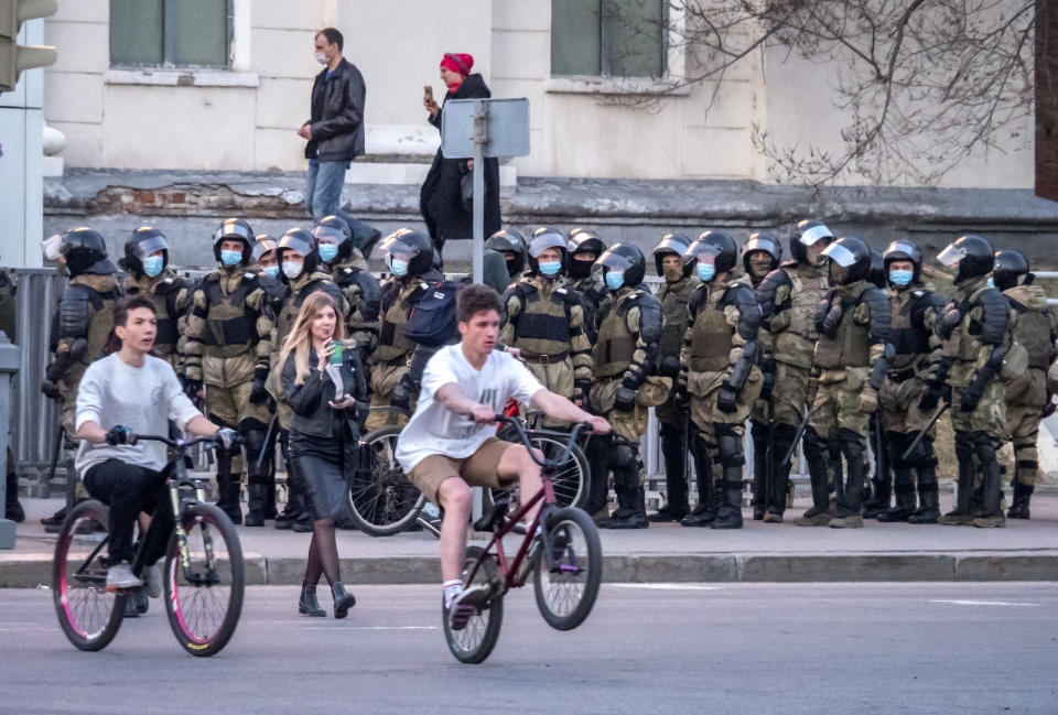 Russian policemen stand in preparation for a possible opposition rally in support of jailed opposition leader Alexei Navalny in Khabarovsk, 6,100 kilometers (3,800 miles) east of Moscow, Russia, Wednesday, April 21, 2021. Navalny's team has called for nationwide protests on Wednesday following reports that the politician's health was deteriorating in prison, where he has been on hunger strike since March 31. Russian authorities have stressed that the demonstrations were not authorized and warned against participating in them. (AP Photo/Igor Volkov)