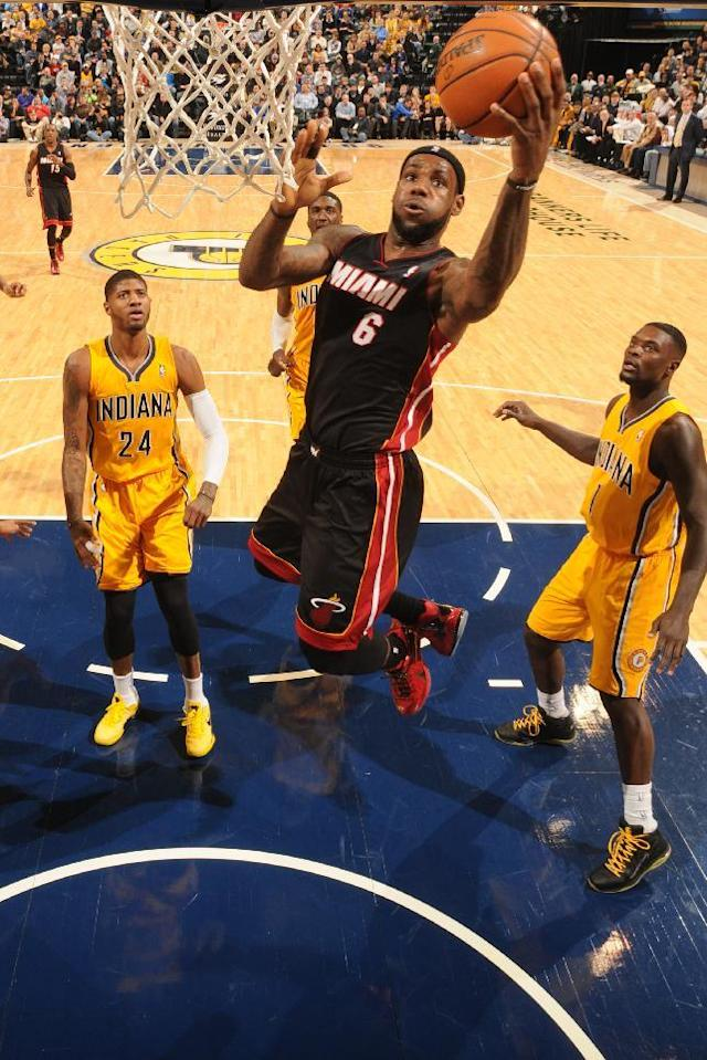 INDIANAPOLIS - DECEMBER 10: LeBron James #6 of the Miami Heat drives to the basket against the Indiana Pacers at Bankers Life Fieldhouse on December 10, 2013 in Indianapolis, Indiana. (Photo by Ron Hoskins/NBAE via Getty Images)