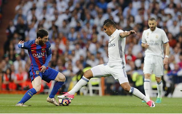 <span>Messi dinks the ball over Casemiro's outstretched foot, and in an instant, is away</span> <span>Credit: rex features </span>
