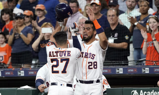 Houston Astros' Jose Altuve (27) is congratulated by Robinson Chirinos (28) after hitting a home run against the Detroit Tigers during the first inning of a baseball game Tuesday, Aug. 20, 2019, in Houston. (AP Photo/David J. Phillip)