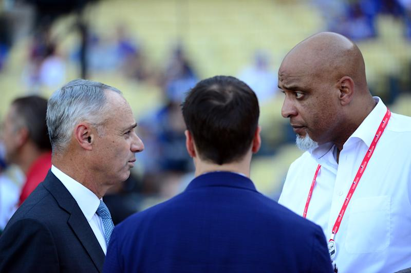 LOS ANGELES, CA - OCTOBER 25: Major League Baseball Commissioner Robert D. Manfred Jr. talks with Executive Director of the Major League Baseball Players Association Tony Clark during batting practice prior to Game 2 of the 2017 World Series between the Houston Astros and the Los Angeles Dodgers at Dodger Stadium on Wednesday, October 25, 2017 in Los Angeles, California. (Photo by LG Patterson/MLB via Getty Images)