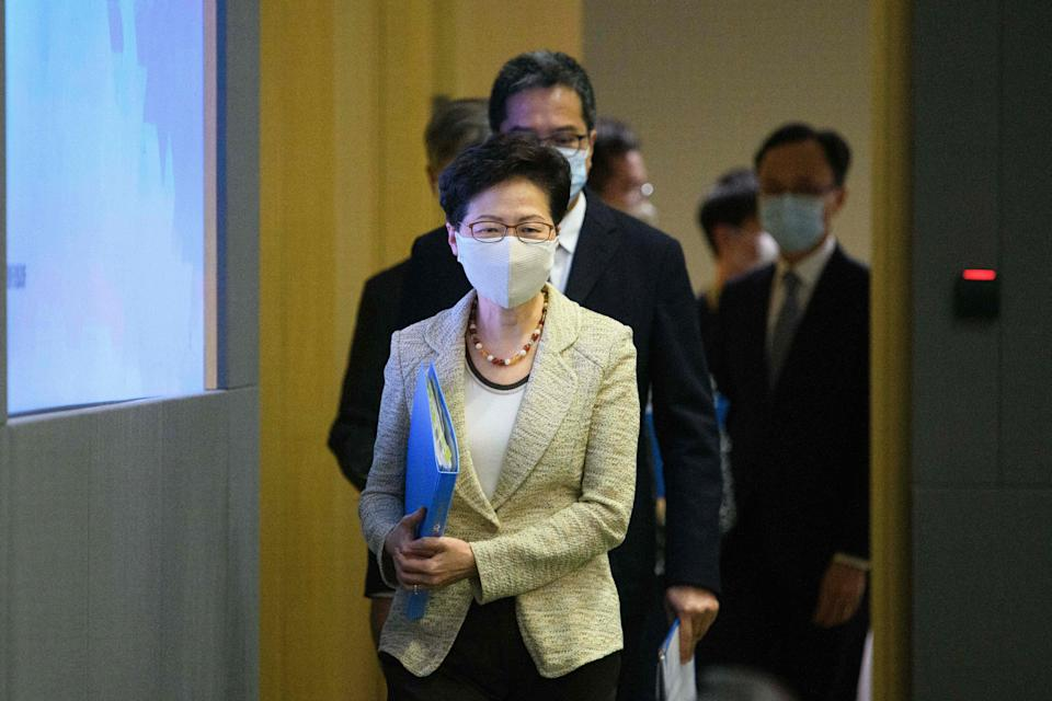 Hong Kong Chief Executive Carrie Lam and other government officials arrive for a press conference at the government headquarters in Hong Kong on August 21, 2020, to provide details of the citywide COVID-19 testing initiative, due to start on September 1. (Photo by Anthony WALLACE / AFP) (Photo by ANTHONY WALLACE/AFP via Getty Images)
