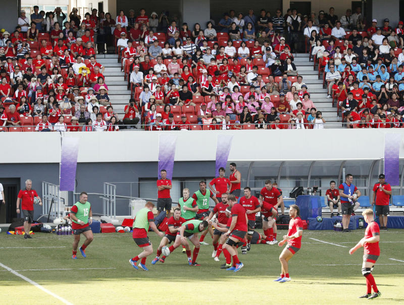 Wales' rugby team players work out in front of the spectators in Kitakyushu, western Japan, Monday, Sept. 16, 2019, ahead of the Rugby World Cup in Japan. (Kyodo News via AP)