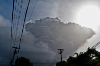 Ash rises into the air as La Soufriere volcano erupts on the eastern Caribbean island of St. Vincent, seen from Chateaubelair, Friday, April 9, 2021. (AP Photo/Orvil Samuel)