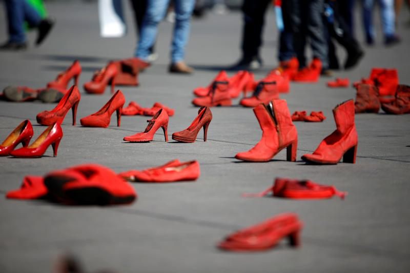 Pairs of women's red shoes, put on display by Mexican visual artist Elina Chauvet to protest against gender violence and femicide, are pictured at Zocalo square in Mexico City, Mexico January 11, 2020. REUTERS/Gustavo Graf