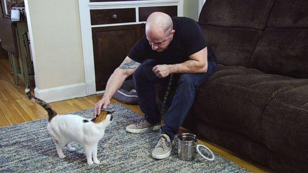 PHOTO: An undated photo shows Mason Caminiti petting a cat. (ABC News)
