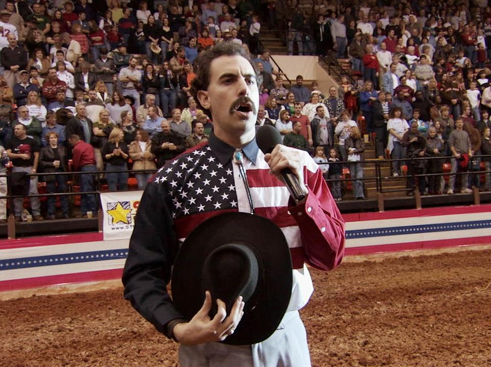 Very nice: Sacha Baron Cohen incites the fury of a crowd as he mangles the US anthem while singing at a rodeo (Fox)