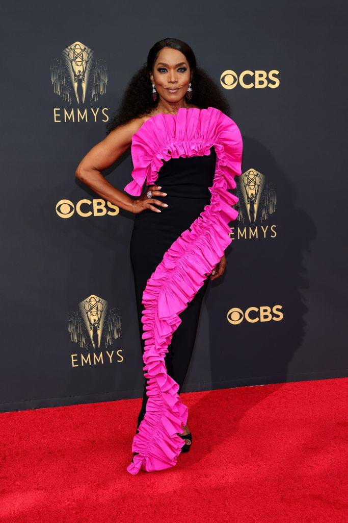 """<p>The """"Black Panther"""" star opted for a bold pink and black look by Canadian designer Greta Constantine.<em> (Image via Getty Images)</em></p>"""