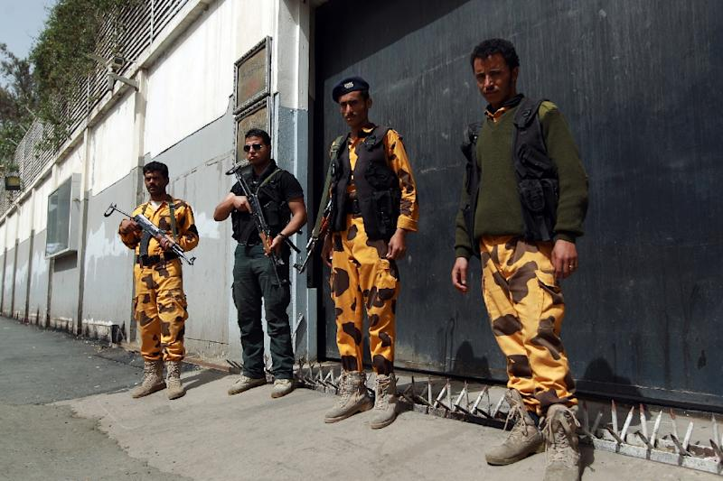 Yemeni soldiers stand guard outside the Egyptian embassy after it was shut down on February 23, 2015, in the capital Sanaa (AFP Photo/Mohammed Huwais)
