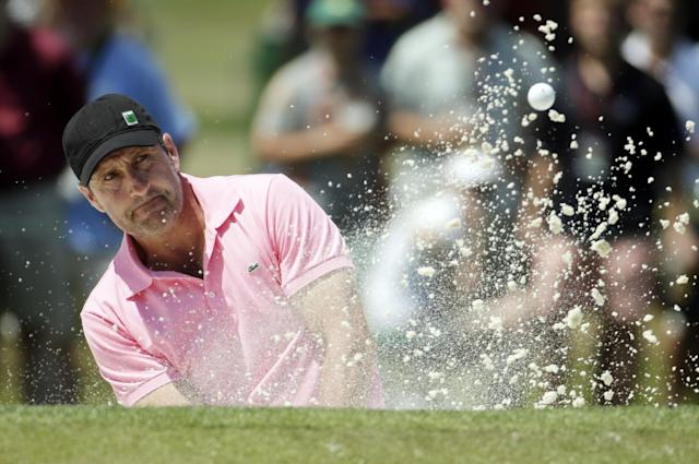 Jose Maria Olazabal, of Spain, hits his second shot out of a bunker on the seventh green during the fourth round of the Masters golf tournament Sunday, April 13, 2014, in Augusta, Ga. (AP Photo/Chris Carlson)