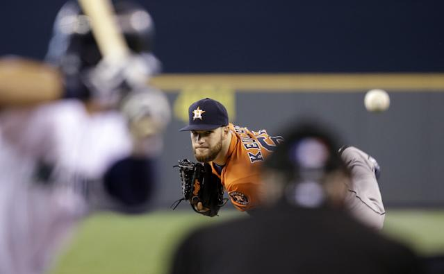 Houston Astros starting pitcher Dallas Keuchel throws against Seattle Mariners' Stefen Romero in the first inning of a baseball game on Sunday, May 25, 2014, in Seattle. (AP Photo/Elaine Thompson)