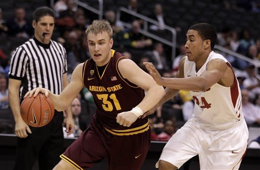 Arizona State's Jonathan Gilling (31) drives away from Stanford's Josh Huestis during the first half of an NCAA college basketball game at the Pac-12 Conference tournament in Los Angeles, Wednesday, March 7, 2012. (AP Photo/Jae C. Hong)