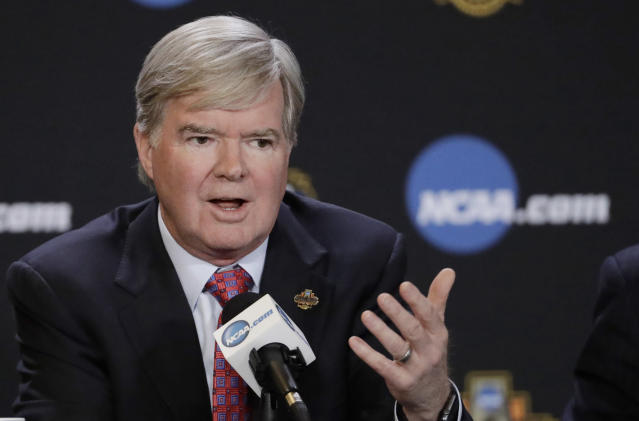 "FILE - In this March 30, 2017, file photo, NCAA President Mark Emmert answers a question during a news conference in Glendale, Ariz. The NCAA is opening a door for states with legalized sports gambling to host NCAA championship events. The governing body for college sports on Thursday, May 17, 2018, announced a ""temporary"" lifting of a ban that prevented events like college basketball's NCAA Tournament from being hosted in states that accept wagers on single games. (AP Photo/David J. Phillip, File)"
