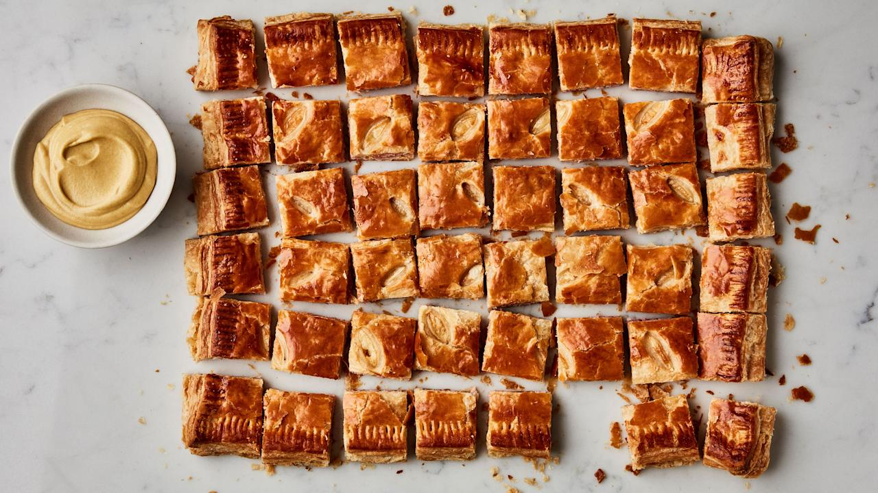 """This recipe is one of our favorites from Martha Stewart's <em>Entertaining</em>, our December 2018 <a href=""""https://www.bonappetit.com/story/were-starting-cookbook-club?mbid=synd_yahoo_rss"""">Cookbook Club</a> pick. These are the perfect cocktail party appetizer, but you can also cut it into larger portions and serve with a simple side salad for a satisfying yet light meal. <a href=""""https://www.bonappetit.com/recipe/ham-and-cheese-feuillete?mbid=synd_yahoo_rss"""">See recipe.</a>"""