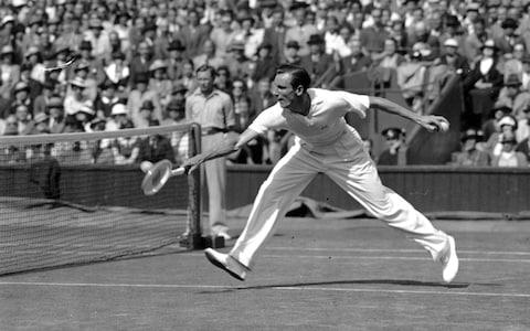 English champion Fred Perry in a semi-final against Donald Budge in the 1930s. - Credit: J A Hampton/Getty