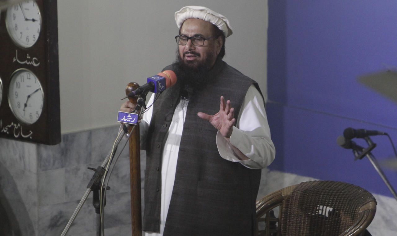 Hafiz Saeed, head of the Pakistani religious party, Jamaat-ud-Dawa, gives Friday sermon at a mosque in Lahore, Pakistan, Friday, Nov. 24, 2017. Pakistani authorities acting on a court order released a U.S.-wanted militant Friday who allegedly founded a banned group linked to the 2008 Mumbai, India attack that killed 168 people, his spokesman and officials said. (AP Photo/K.M. Chaudary)