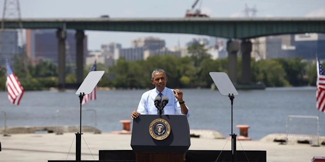 U.S. President Barack Obama speaks about transportation infrastructure during a visit to the Port of Wilmington in Wilmington, Delaware, U.S. on July 17, 2014. REUTERS/Kevin Lamarque/File Photo