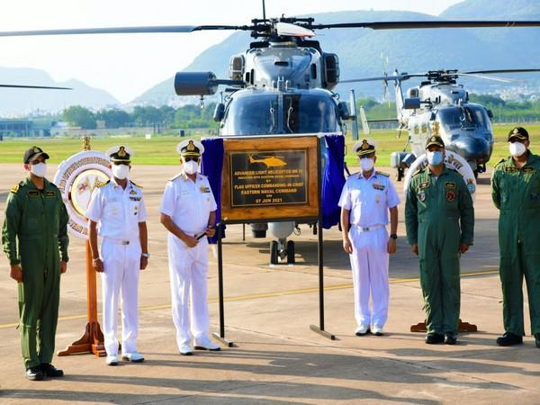 Navy officers with ALH MK III. (Photo/ANI)
