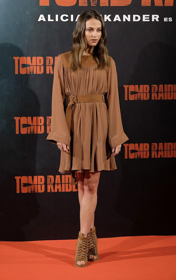 <p>On February 28th, Alicia Vikander kick-started her tour in Madrid wearing a tan dress by French fashion label Chloé. The actress teamed the look with her signature soft waves and co-ordinating heels. <em>[Photo: Getty]</em> </p>