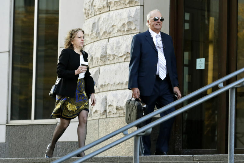 Attorneys for the plaintiffs Linda Singer, left, and Joe Rice enter the U.S. Federal courthouse, Monday, Oct. 21, 2019, in Cleveland. The nation's three dominant drug distributors and a big drugmaker have reached a tentative deal to settle a lawsuit related to the opioid crisis just as the first federal trial over the crisis was due to begin Monday, according to a lead lawyer for the local governments suing the drug industry. (AP Photo/Tony Dejak)