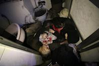<p>Dead bodies of a Syrian family are seen after Assad regime forces allegedly conducted poisonous gas attack to Douma town of Eastern Ghouta in Damascus, Syria on April 7, 2018. (Photo: Stringer/Anadolu Agency/Getty Images) </p>