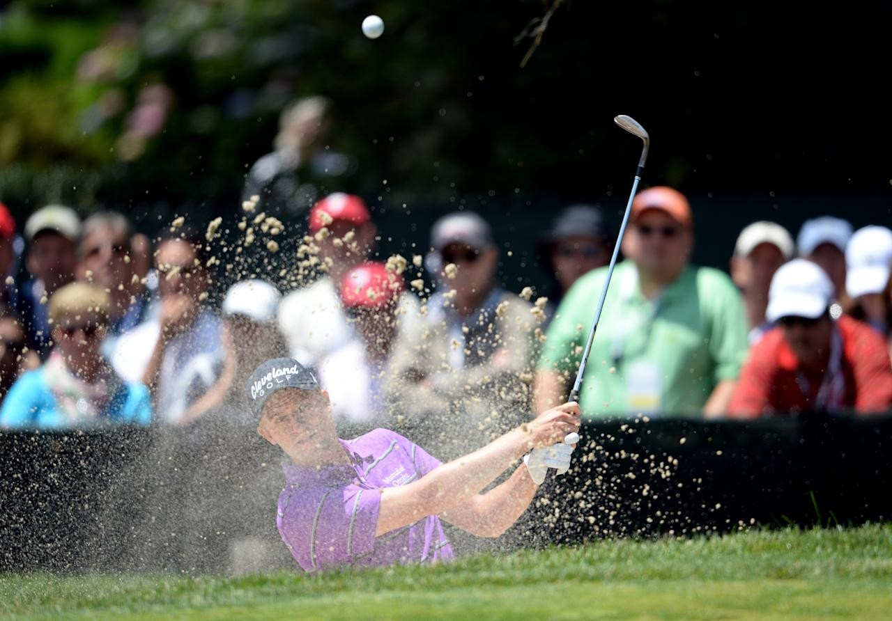 ARDMORE, PA - JUNE 14:  Russell Knox of Scotland hits his third shot from a bunker on the 15th hole during Round Two of the 113th U.S. Open at Merion Golf Club on June 14, 2013 in Ardmore, Pennsylvania.  (Photo by Ross Kinnaird/Getty Images)