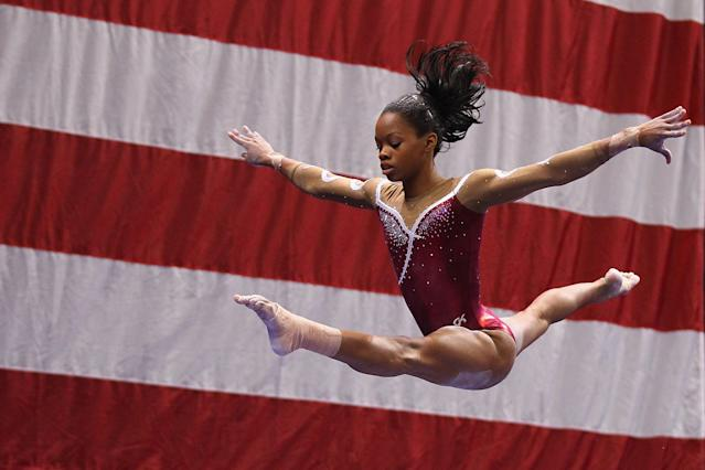 ST. LOUIS, MO - JUNE 8: Gabrielle Douglas competes on the balance beam during the Senior Women's competition on day two of the Visa Championships at Chaifetz Arena on June 8, 2012 in St. Louis, Missouri. (Photo by Dilip Vishwanat/Getty Images)