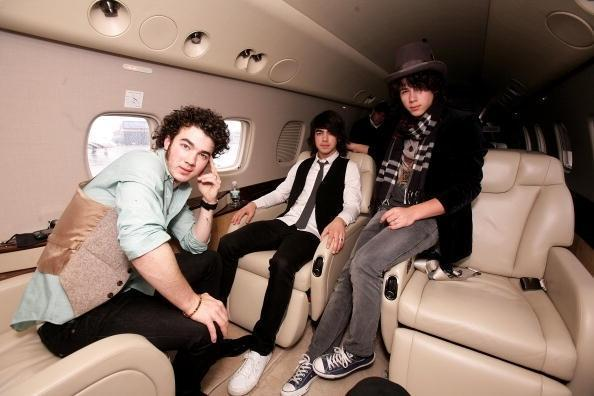 <strong>Jonas Brothers</strong> The Jonas Brothers know how to arrive in style. Here they are pictured aboard an Embraer RJ135 private jet after touching down in the UK at Luton Airport.