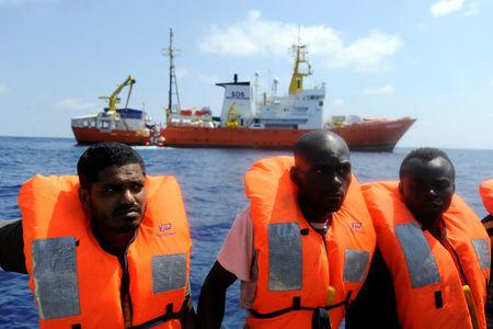FILE PHOTO: Migrants are rescued by SOS Mediterranee organisation and Doctors Without Borders during a search and rescue (SAR) operation with the MV Aquarius rescue ship in the Mediterranean Sea