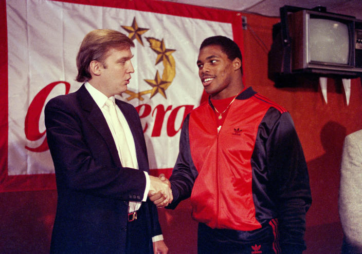 Donald Trump shakes hands with Herschel Walker in New York after agreement on a 4-year contract with the New Jersey Generals USFL football team on March 8, 1984. The New Jersey Generals have been largely forgotten, but Trump's ownership of the team was formative in his evolution as a public figure and peerless self-publicist. With money and swagger, he led a shaky and relatively low-budget spring football league, the USFL, into a showdown with the NFL. (Photo: Dave Pickoff/AP)