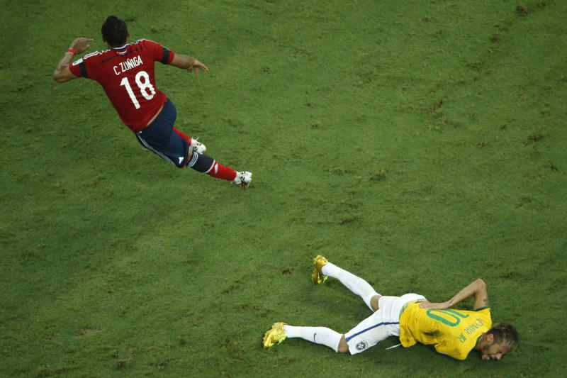 Brazil's forward Neymar reacts on the ground after being injured following a foul by Colombia's defender Juan Camilo Zuniga (L) at the Castelao Stadium in Fortaleza during the 2014 FIFA World Cup on July 4, 2014