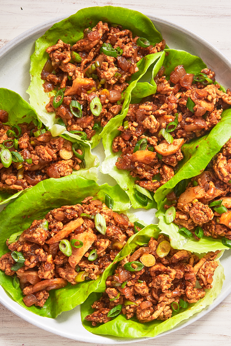 "<p>The sauce for these chicken lettuce wraps is extremely addicting. The sriracha adds a little heat, but you can definitely leave it out if you like (although, we like to add a little extra 😉).</p><p>Get the <a href=""https://www.delish.com/uk/cooking/recipes/a29891044/asian-lettuce-wraps-recipe/"" rel=""nofollow noopener"" target=""_blank"" data-ylk=""slk:Asian Lettuce Wraps"" class=""link rapid-noclick-resp"">Asian Lettuce Wraps</a> recipe.</p>"