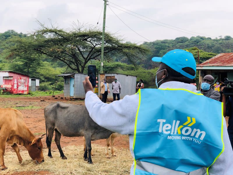 FILE PHOTO: Telkom Kenya CEO Mugo Kibati uses his cell phone to test the Loon technology internet via video call as Alphabet Inc begins offering the world's first commercial high-speed internet using balloons to villagers in Radad