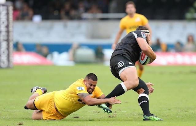 Sharks' Thomas du Toit (R) is tackled by Jaguares' Roberto Tejerizo during their Super XV match at Kingspark Rugby Stadium on April 8, 2017, in Durban (AFP Photo/ANESH DEBIKY)