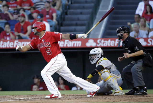 Los Angeles Angels' Albert Pujols drives in a run with a single against the Pittsburgh Pirates during the fourth inning of a baseball game Wednesday, Aug. 14, 2019, in Anaheim, Calif. (AP Photo/Marcio Jose Sanchez)